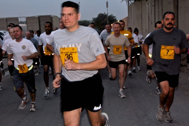 "<b>BAGHDAD —</b> U.S. Army Lt. Col. Brian Steed, a security assistance officer with Iraq Security Assistance Mission, is surrounded by fellow service members at Forward Operating Base Union III as they participate in the five-mile ""Army 10 Miler Shadow Run"" Oct. 8."