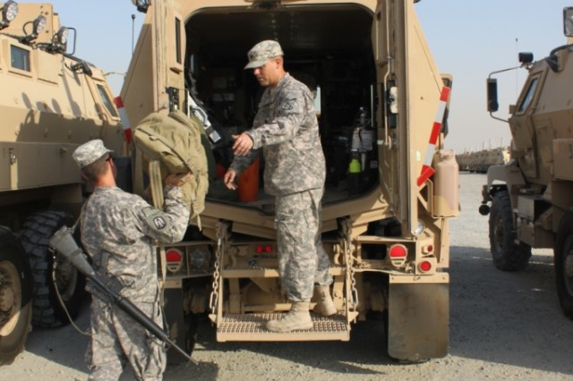 Soldiers from 1st Platoon, 64th Trans. Co., Convoy Escort Team, pack their gear and equipment in preparation for their next mission. The CET escorts and provides security to convoys traveling throughout Kuwait and Iraq.