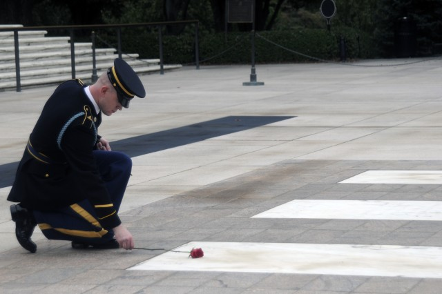 Sergeant Kyle Obrosky, a Topeka, Kansas native, lays a rose at the Tomb of the Unknowns in remembrance of his final walk on October 5th. Sentinels lay roses signifying leaving the Tomb, and the love they have for the job and the Unknowns.  The 3rd U.S. Infantry Regiment (The Old Guard) conducts memorial affairs to honor fallen comrades as well as ceremonies and special events to represent the Army, communicating its story to our Nation's citizens and the world.