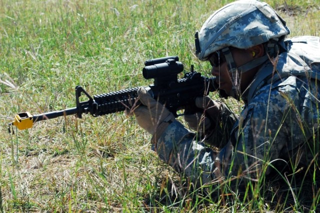 FORT HOOD, Texas- Spc. Samnang Phan, a field artillery automated tactical data systems specialist with B Battery, 3rd Battalion, 82nd Field Artillery Regiment, 2nd Brigade Combat Team, 1st Cavalry Division, peers through the scope of his M4 rifle for targets during training, Oct. 6.