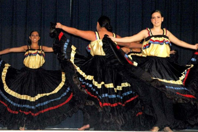 From left, Sarah Sevillano, Margareth Olivo, Florella Sevillano and Raquel Montoya, not shown, from the dance group D4C, perform a traditional Columbian dance during Aberdeen Proving Ground's annual Hispanic American Heritage Month Celebration held at the Aberdeen Area Recreation Center Sept. 29.