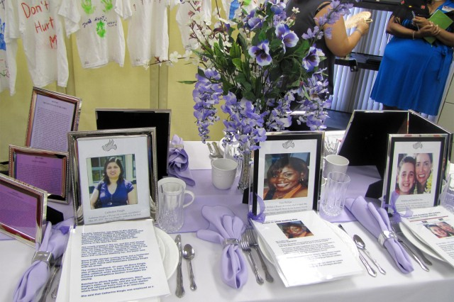 SCHOFIELD BARRACKS, Hawaii - Empty place settings at Army Community Service memorialize individuals who have been hurt or murdered due to domestic violence.