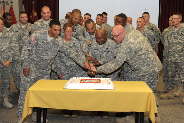 3d ESC commander, Brig. Gen. Robin Akin (second from left), a native of Nashville, Tenn.,  joins senior and junior NCOs from the 3d ESC's Headquarters Company and the 233rd Transportation Company in cutting a cake at the end of the 3d ESC's NCO Induction Ceremony on Sept. 30 at the Patton Museum's Abrams Auditorium. (U.S. Army photo)