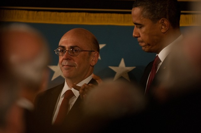 Phil Miller, father of Staff Sgt. Robert Miller, stands next to President Barack Obama as he and his family are recognized at a White House Medal of Honor ceremony in Washington on Wednesday, Oct 6, 2010, to honor their son, and Green Beret, who was awarded our nation's highest medal posthumously for his courage and bravery under fire in Afghanistan.