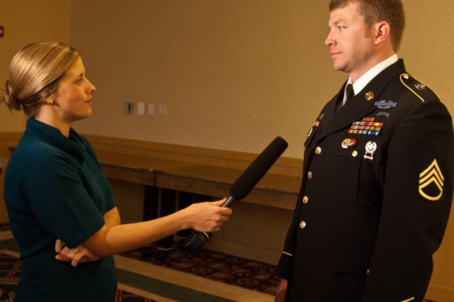 Staff Sergeant Nick McGarry talks with Orlando-based reporter Catherine Reynolds on Wednesday, Oct 6, 2010, prior to attending a White House ceremony in Washington to honor Staff Sgt. Robert Miller, his best friend. Miller was awarded the Medal of Honor posthumously for his actions in Afghanistan in 2008.