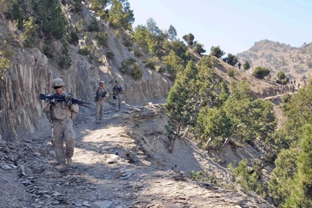 Soldiers of the 1st Squadron, 33rd Cavalry traverse mountain trails in Khowst Province Oct. 8 during a joint air-assault mission with Afghan National Security Forces that netted two weapons caches.