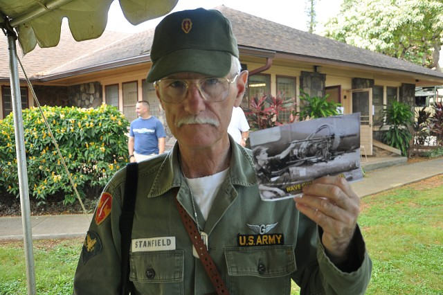 "Jerry Stanfield, a ""Tropic Lightning"" veteran gunner from 1963-1966, holds up a photo of himself during his tour of service with the 25th Infantry Division during the ""Tropic Lightning Museum"" on Schofield Barracks, Hawaii, Oct. 8. Stanfield wore his parts of his original uniform during the event and professed his pride in the division was what made him happy to serve as a historic guide. ""It feels good to wear the uniform again,"" said Stanfield. ""I'll always be a Tropic Lightning Soldier.""(U.S. Army photo by Sgt. Jesus J. Aranda, 25th Infantry Division Public Affairs Office)"