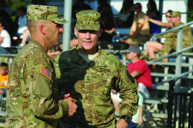 FORT POLK, La. -- Maj. Gen. James Terry (right), commander, 10th Mountain Division, Fort Drum, N.Y., chats with Col. Bruce Antonia, commander, 4th Brigade Combat Team, 10th Mountain Division, after the brigade's deployment ceremony at Honor Field Sept. 30.