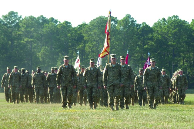 FORT POLK, La. -- Lt. Col. Anthony Coston (center), commander, 94th Brigade Support Battalion, 4th Brigade Combat Team, 10th Mountain Division, leads his troops to their position on Honor Field during the brigade's deployment ceremony Sept. 30.