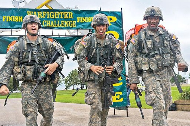 Cpl. Christopher J. Vazquez, Spc. Gregory A. Bartholomew, and Spc. Deante J. Tharp 'The Old Guard' are the first team to cross the finish line in the final event, the 15-mile road march. The 14th annual Warfighter Challenge at Fort Leonard Wood, Missouri brings military police units throughout the Army together to determine who is the best in the MP field.