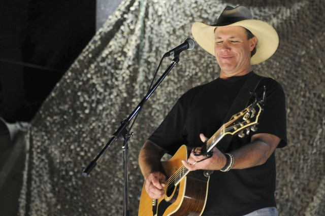 """BAGHDAD Aca,!"""" Country music veteran Michael Peterson performs for troops at Joint Security Station Shield Oct. 10."""