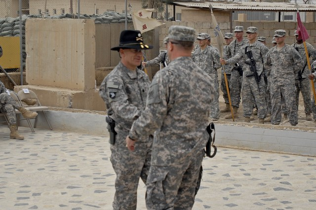 CONTINGENCY OPERATING SITE MAREZ, Iraq - Lt. Col. Bill Galbraith (left), commander of the 27th Brigade Support Battalion, 4th Advise and Assist Brigade, 1st Cavalry Division and Lt. Col. James Kazmierczak, commander of the outgoing 26th Brigade Support Battalion, 2nd Brigade Combat Team, 3rd Infantry Division shake hands during the unit's transfer of authority ceremony, Oct. 11.