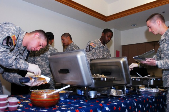 TEMPLE, Texas-Soldiers from Headquarters and Headquarters Company, 2nd Brigade Combat Team, 1st Cavalry division, prepare breakfast tacos during a fundraising event at the William R. Courtney Texas State Veterans Home, in Temple, Texas, Oct. 12.  The proceeds from the fundraiser went to the Alzheimer's Association-Texas Chapter, for research and assisted living purposes.