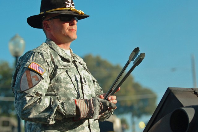FORT HOOD, Texas - 1st Sgt. Joel Lardy, Company B, 3rd Battalion, 227th Aviation Regiment, 1st Air Cavalry Brigade, 1st Cavalry Division, stands ready to turn sausages, Oct. 12, before a concert held by the division's Jazz Band at the First Team's museum.