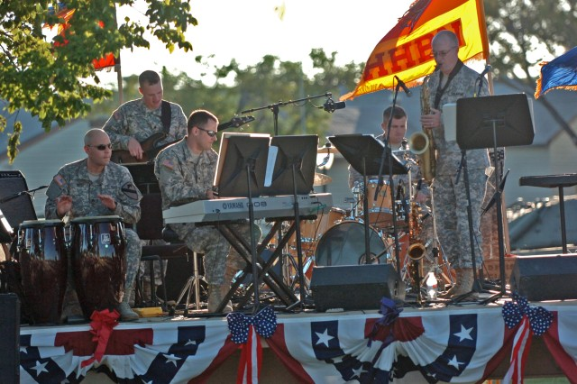 """FORT HOOD, Texas - The 1st Cavalry Division's Jazz Quintet performs for an audience, Oct. 12, at the division's museum.  This was the final concert as part of the """"Preserving the Legend"""" series by the 1st Cav. Div. band."""