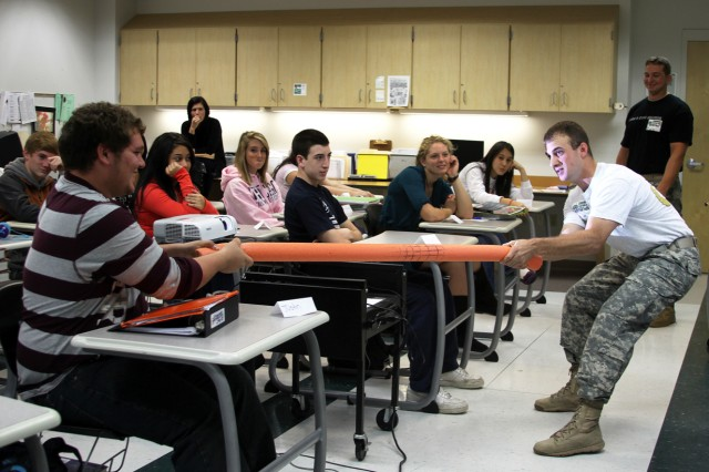 """Justin Klumack, a Cornwall High School student, pulls on a rubber tube held by West Point Class of 2011 Cadet Nick Reisweber, a Civil and Mechanical Engineering major who was teaching some engineering topics to the class. Reisweber and Class of 2011 Cadet Dan Kitchell, West Point engineering faculty and other staff taught math classes Oct. 6. This is the second year """"Engineering Day"""" has been scheduled at the high school."""