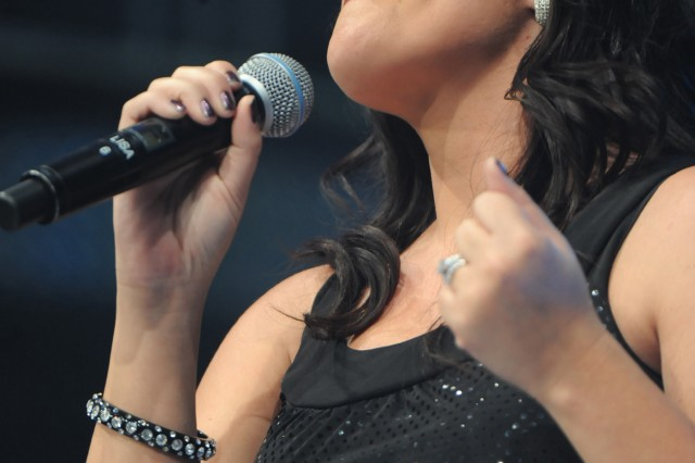 """2009 Operation Rising Star Contestant Lisa Pratt, an Army wife from Fort Carson, Colo., sings Faith Hill's """"There Will Come a Day"""" during Operation Rising Star semifinals last year at Wallace Theater on Fort Belvoir, Va..(cleared for public release, not for commercial use, attribution requested.)"""