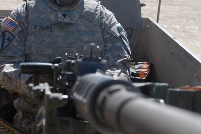 FORT HOOD, Texas - Colorado Springs native, Spc. Matt Burks, a team leader assigned to Company B, 2nd Battalion, 8th Cavalry Regiment, 1st Brigade Combat Team, 1st Cavalry Division, prepares to fire the .50-caliber machine gun during the unstabilized gunnery range, here, Oct. 7.