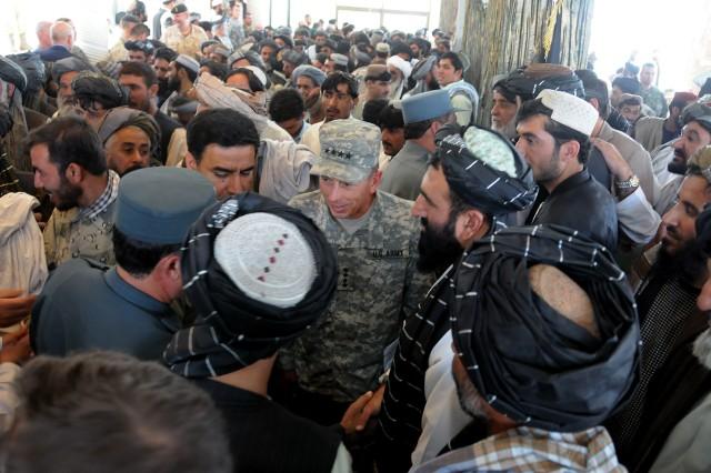 Gen. David H. Petraeus attends shura with Karzai