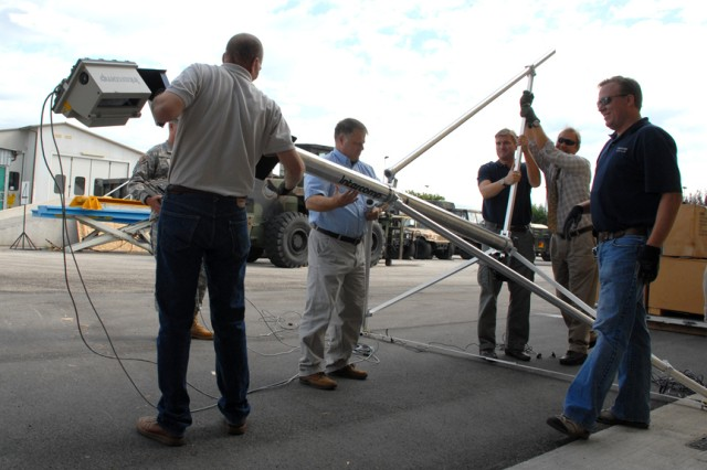 U.S. Army Africa and U.S. Army Garrison Vicenza logisiticians prepare the Deployable Automated Cargo Measurement System for training at Caserma Ederle, Vicenza, Italy.