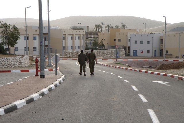 U.S. Army Corps of Engineers photo by Justin Ward A soldier walks alone on Shomria, an Israeli basic training base in central Israel constructed through the U.S. Army Corps of Engineers Europe District. The district recently finished a simulator project on the base.