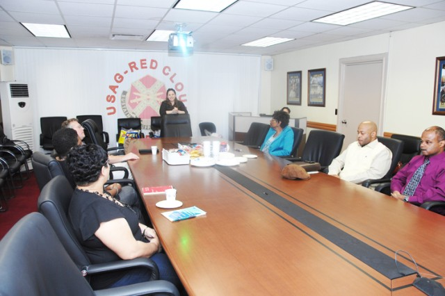 U.S. Army Garrison customer service officer Abigail Kim talks with civilians employees from the garrison their concerns during a civilian focus group meeting Sept. 24.