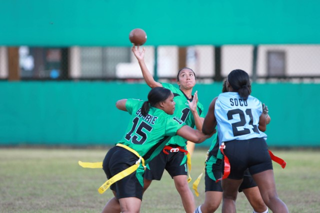 RED CLOUD GARRISON, South Korea - Casey Cougars quarterback Veronica Bangi heaves a pass down field under heavy pressure from the Humphreys Garrison post-level women's flag football team. The team from Warrior Country lost a pair of games to Humphreys at Red Cloud Garrison Oct. 9 to fall to 1-3 on the season.