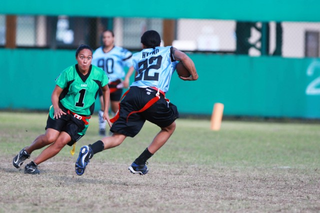 RED CLOUD GARRISON, South Korea - Casey Cougars outside linebacker Veronica Bangi zeroes on the Humphreys ball carrier during a post-level women's flag football game here Oct. 9. The season ends with a tournament at Yongsan Garrison Dec. 5.