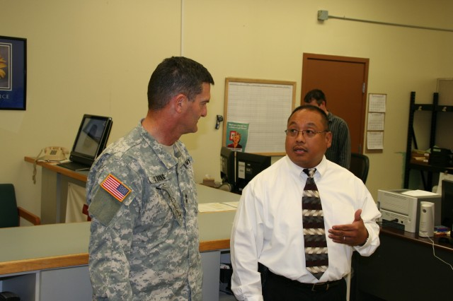 Mark Gallo briefs Maj. Gen. Randolph P. Strong on capabilities of the Tobyhanna Army Depot Forward Repair Activity at Joint Base Lewis-McChord, Wash.  Strong visited the Joint Base to participate in the sixth Combined Equipping Conference of 2010.