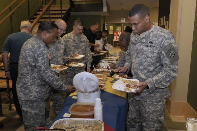 Dozens of 81st Regional Support Command Soldiers, civilian employees and contractors fill their plates with a wide selection of Hispanic food during an Oct. 14 celebration honoring the Hispanic heritage and their contribution to the growth of American and the armed forces at the Spc. Thomas Caughman Army Reserve Center located on Fort Jackson, S.C.