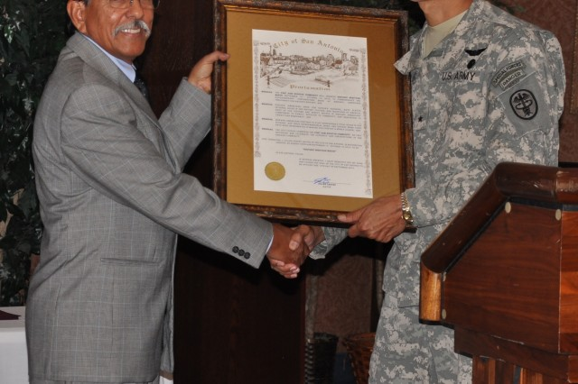 Brig. Gen. Joseph Caravalho Jr., commanding general, Brooke Army Medical Center and Southern Regional Medical Command, presents guest speaker Richard Lopez a framed copy of the Hispanic Heritage Month proclamation Oct. 1 at the Sam Houston Club.