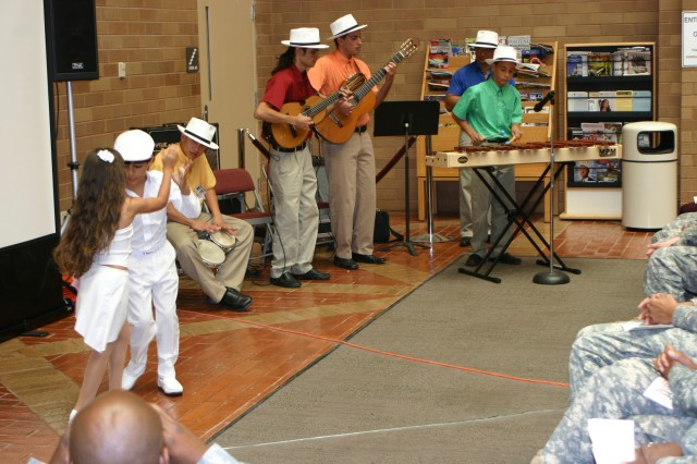 A large crowd gathered in the Brooke Army Medical Center medical mall Oct. 4 to watch Puerto Rican group Sabor a Cultura entertain with their unique acoustic-style music.