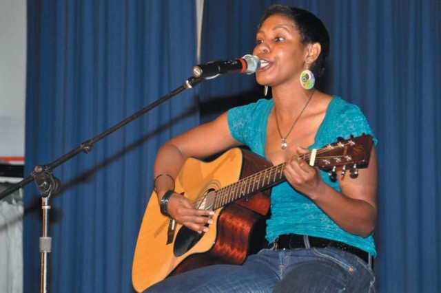 "Tikiela Mims sings her original song, ""Focus,"" on the way to a first-place win during the APG Festival of the Arts/Adults Got Talent Showcase, at the Aberdeen Area Recreation Center Sept. 25."