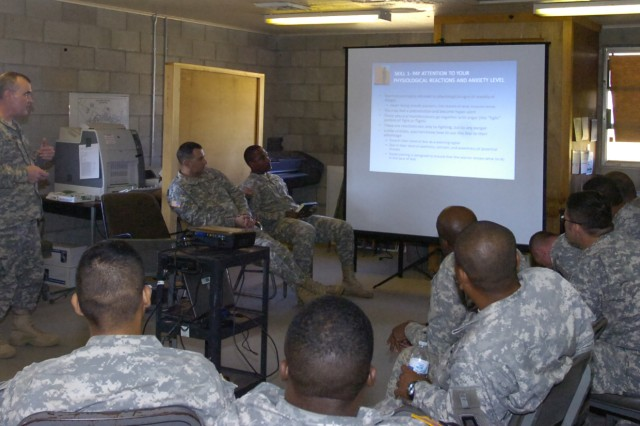 Lt. Col. Timothy Gauthier explains to his Soldiers that paying attention to unconscious reactions to stress and anxiety levels can help a Soldier struggling with PTSD to remain in control of his reactions to that stress.