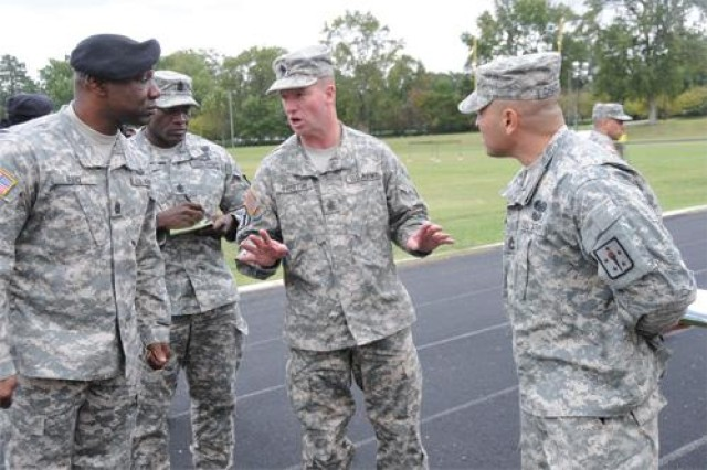 Sergeant Major of the Army Kenneth O. Preston provides guidance and direction to Command Sgt. Maj. Daniel Reid, Logistics Noncommissioned Officer Academy commandant; 1st Sgt. LaDerek Green, Headquarters and Headquarters Company, Combined Arms Support Command; and Sgt. 1st Class Stanley Chandarlis, NCOA, during a walk-thru for the Best Warrior Competition. The SMA was shown what the Army Physical Fitness Test would look like during the event scheduled for Sunday - Oct. 22 at Fort Lee.