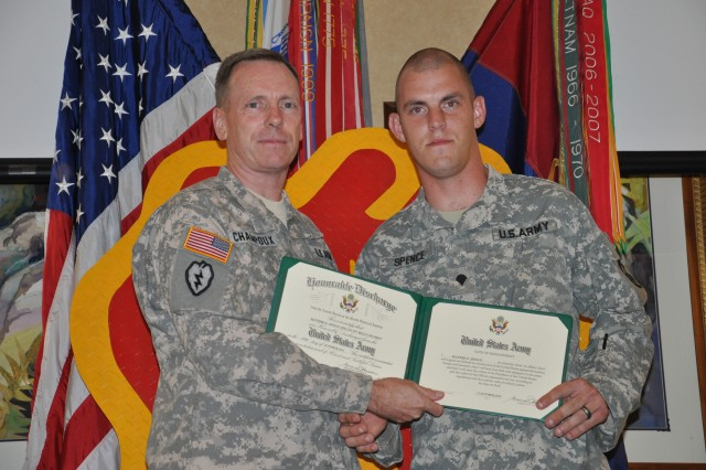 "Spc. Richard Alan Spence, Headquarter and Headquarter Company, 2nd Battalion, 27th Infantry Regiment, 3rd Brigade Combat Team, receives a Certificate of Appreciation for reenlisting during the 25th Infantry Division Commanding General's Retention Celebration held at the Nehelani Club, Schofield Barracks, Hawaii, Oct. 13. ""I want to thank this community, leadership of this division, and the units that allow the Soldiers to see the merit in their service,"" said Maj. Gen Bernard S. Champoux, commanding general, 25th Inf. Div. during his speech at the ceremony."