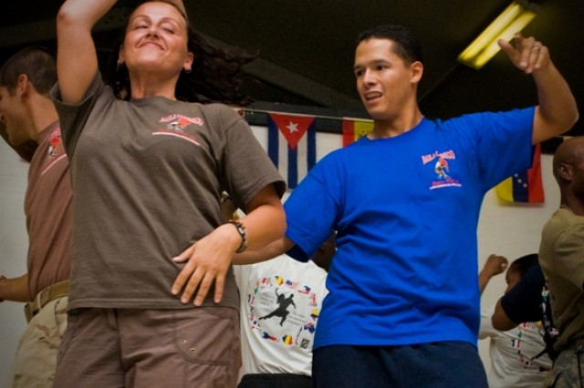 Members of the Kandahar Airfield Salsa Dance Team perform a salsa routine during the Hispanic Heritage Month Ceremony, Oct. 13 at Kandahar Airfield, Afghanistan . The team practiced for 2 months in order to prepare for the event.
