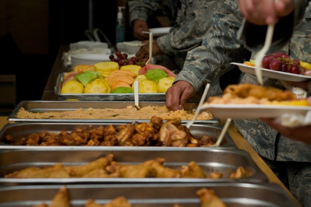 Attendees sample Latin foods after the Hispanic Heritage Month Ceremony Oct. 13 at Kandahar Airfield, Afghanistan.