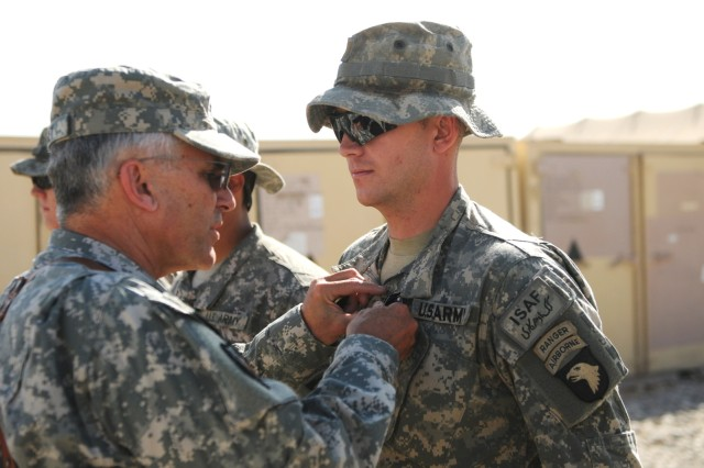 FORWARD OPERATING BASE HOWZ-E-MADAD, KANDAHAR, AFGHANISTAN – Gen. George W. Casey, the Army Chief of Staff, pins a Purple Heart on 2nd Lt. Taylor Murphy, Company B, 1st Battalion, 502nd Infantry Regiment, 2nd Brigade Combat Team, 101st Airborne Division (Air Assault), during an awards ceremony at Forward Operating Base Wilson, Kandahar province, Afghanistan, Oct. 7. Murphy was awarded the medal after receiving a gunshot wound to his wrist while on patrol in the Zharay district, Sept. 16. (U.S. Army photo by Spc. Joe Padula, 2nd BCT PAO, 101st Abn. Div.)