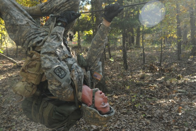Cadet Ryan O'Neil, Washington University, St. Louis, Mo., navigates over a one-rope bridge during the 3rd ROTC Brigade's Ranger Challenge competition, Saturday, at Fort Leonard Wood.