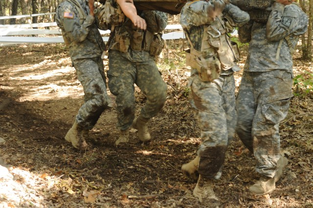 Cadets carry a mannequin representing a wounded Soldier during the 3rd ROTC Brigade's Ranger Challenge competition.