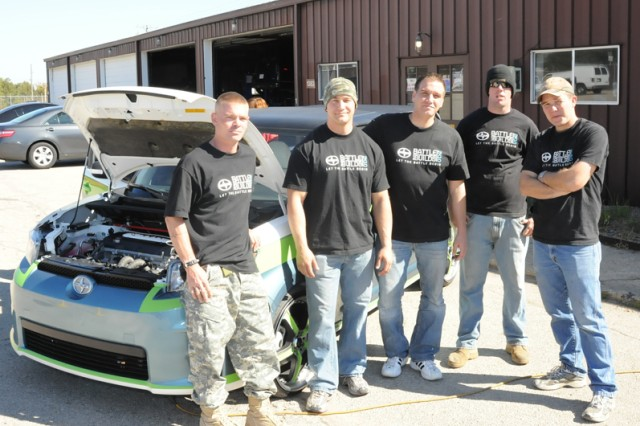 From left to right, Spc. Dustin Reel, Spc. Harold Yeo, Pfc. Nate Machowski, Spc. Joseph Schneider and Pfc. Daniel Ward, all 55th Maneuver Augmentation Company, 4th Maneuver Enhancement Brigade, stand by their customized Scion xB as the Army's entry into Toyota's Scion Battle of the Builds. The competition pitted the different services against each other to produce the best customized car. The contest neither infers or implies any endorsement by the Department of Defense.