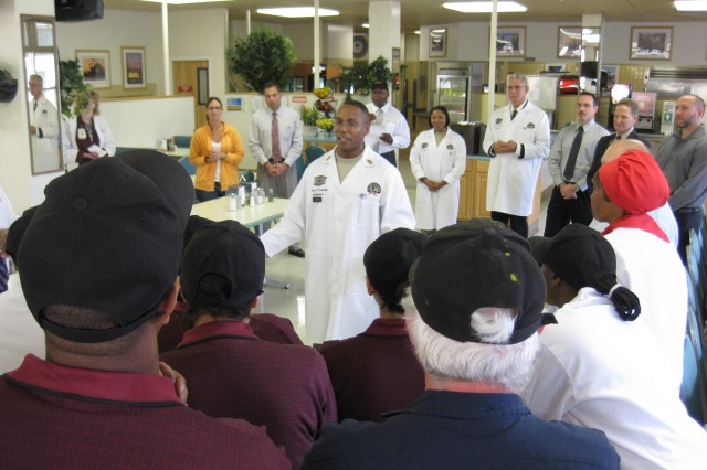 Sgt. Maj. Michael A. Dixon of the evaluation team has words of congratulation for the Belas Hall staff at an informal assembly in the facility's dining area.