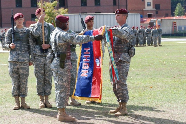 Lt. Col. David Leach and Command Sgt. Maj. Willie Williams retire the colors of the 82nd Airborne Division Special Troops Battalion and unveil the colors of the new Division Headquarters and Headquarters Battalion at Stang Field, Oct. 15. Leach and Williams will lead the new unit, which consists of the 82nd command group and its supporting units. The DSTB recently served 15 and 14 month deployments at Bagram Airfield, Afghanistan in 2007 and 2009. This completes the final stage of transformation of the 82nd Airborne Division Command. (U.S. Army photo by Spc. Todd Willis, 82nd Airborne Division Public Affairs)