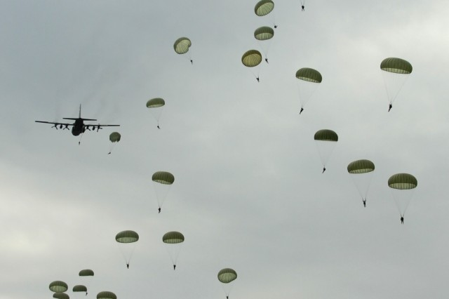FORT BRAGG, N.C. - Sixty-four paratroopers, from the 82nd Airborne Division's Special Troops Battalion, honor the 33 rescued Chilean miners during a jump on Fort Bragg's Normandy Drop Zone, Oct. 14. The jumpers joined Chilean Army Col. Cristian Guedelhoefer, who was the primary jumpmaster, to honor the rescued Chilean miners.  (U.S. Army photo by Staff Sgt. Andrew Alfano, 82nd Airborne Division Public Affairs)