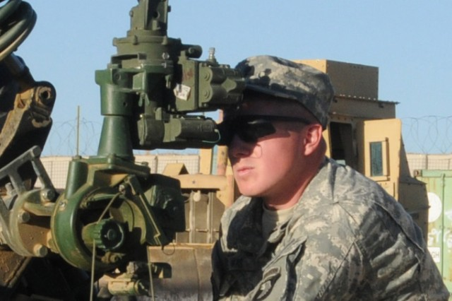 PAKTIKA PROVINCE, Afghanistan - U.S. Army Spc. Adam C. Haas, a cannon crewmember with Battery A, 4th Battalion, 320th Field Artillery Regiment, 4th Brigade Combat Team, 101st Airborne Division, and native of Ionia, Mich., sites in the M119 Howitzer Oct. 6 while cross training at Forward Operating Base Khayr-Khot Castle here. The cannon crew uses their down time to cross train all the Soldiers on every position on the gun. (Photo by U.S. Army Spc. Luther L. Boothe Jr., Task Force Currahee Public Affairs)