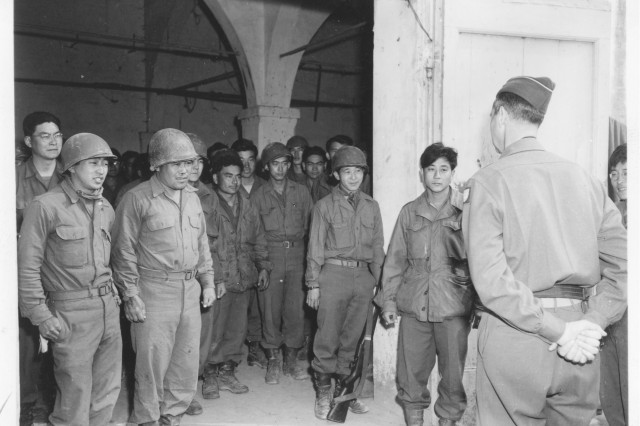 General Mark W. Clark, Commanding General of the 15th Army Group, tours the 92nd Infantry Division area and welcomes the men of the 442nd Regiment.  (Edward M. Almond Collection)
