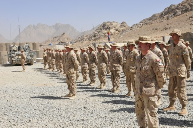 FORWARD OPERATING BASE MA'SUM GHAR, Afghanistan - Canadian soldiers of the 1st Battalion, The Royal Canadian Regiment Battle Group stand in formation before being presented the General Campaign Star medal during a medals parade ceremony, Oct. 7.
