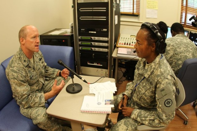 Spc. Jaqueline Baine, right, of the 356th Broadcast Operations Detachment, interviews Air Force Brig. Gen. Robert C. Nolan, commander of the Air Force Flight Test Center during the 2010 Boy Scout Jamboree at Fort A.P. Hill, Va., in August.