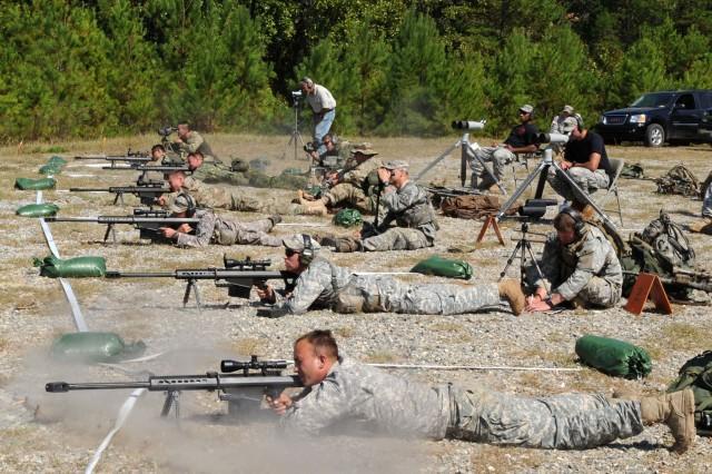 During an orientation class, international competitors examine 50 caliber sniper rifles during the 10th annual International Sniper Competition at Fort Benning, Ga.